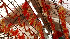 Chinese New Year's Eve in Singapore, Shop Selling Red Decorations, Red Lanterns Stock Footage