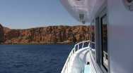 Motor boat POV approaches Rocky Island Stock Footage