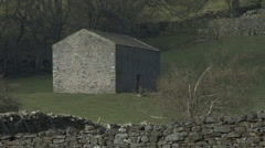 Zoom out from field barn near Reeth, Swaledale. Stock Footage