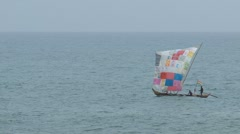 Fisher boat Cape Coast with colorful sail Stock Footage