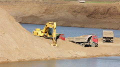 Sandpit - loader dump tipper loads of sand Stock Footage