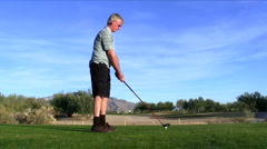 Golfer hits drive off tee V2 - HD Stock Footage