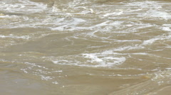 Brown Murky flood water with debris Stock Footage