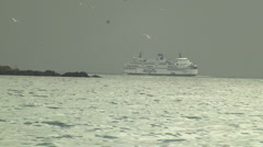 Large Car Ferry Navigating Rocky Coast in Winter Stock Footage