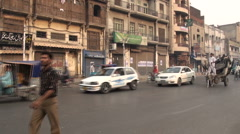Historical buildings, busy traffic, road in Lahore, Pakistan Stock Footage