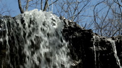 Water falling over the edge of a hill Stock Footage