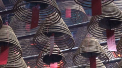 Burning incense in mystical Buddhist temple in Hong Kong Asia Stock Footage