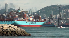 Cargo ship leaves Hong Kong port, container terminal in China Stock Footage