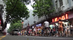 Guangzhou shopping street - two bicycles passing Stock Footage