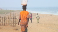 Stock Video Footage of Africa: Young boy hurries along Togo beach
