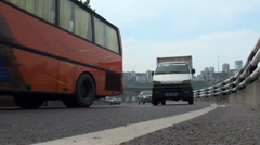 Low angle of traffic driving through a corner in Chongqing China Stock Footage