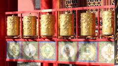 Golden prayer wheels in the sunlight Stock Footage