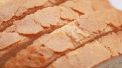 Closeup of sliced bread, it rotate on white Stock Footage