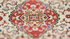 Closeup of carpet, pattern rotates Stock Footage