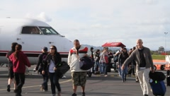 Passengers Getting off Commercial Airliner Stock Footage