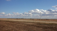 Stock Video Footage of Wind Turbines with Clouds