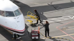 Passengers Getting off Aircraft Stock Footage