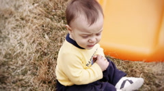 Baby playing in the yard Stock Footage