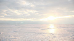 Sunrays and glowing reflection on snowfield form the sunshine, timelapse - stock footage