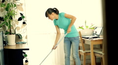 Woman cleaning floor with mop - stock footage