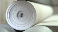 Stock Video Footage of machine rewinds the paper in the roller