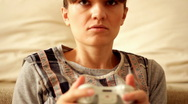 Young exciting woman playing videogames, steadicam shot Stock Footage