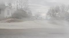 Large Waterspray in street, homes in background Stock Footage