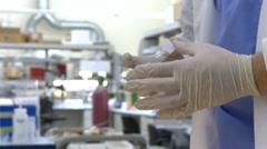 Cryostat Microscope slide preparation in Science Lab - stock footage