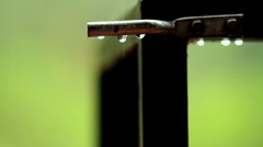 Drops on Gate Latch GFHD - stock footage