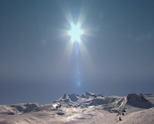 Sun over ski slopes Stock Footage