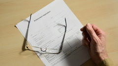 Job applicant with pen 1 Stock Footage