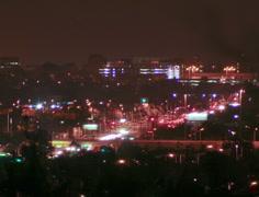 4K Film tight - Night time traffic desert brush silhouette foreground - stock footage