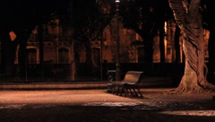 A lonely park bench at night in Sicily - stock footage
