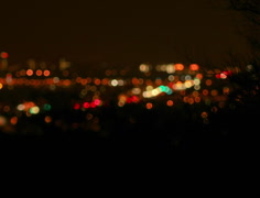 2K film wide Night time traffic soft-focus desert brush silhouette foreground - stock footage