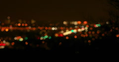 2K Vid wide Night time traffic soft-focus desert brush silhouette foreground - stock footage