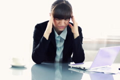 Businesswoman having headache - stock footage