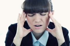 Businesswoman having headache, closeup - stock footage