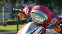 The Headlight of A Bright Red Scooter Stock Footage