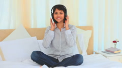 Casual asian lady listening to music Stock Footage