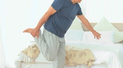 Retired male stretching himself Stock Footage