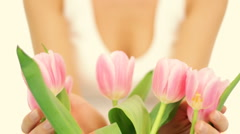 Young romantic woman smell spring tulips, isolated Stock Footage