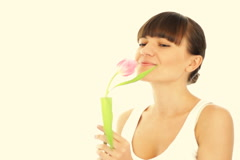 Young romantic woman smell spring tulip, isolated Stock Footage