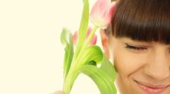 Portrait of young beautiful woman with tulip, closeup  Stock Footage