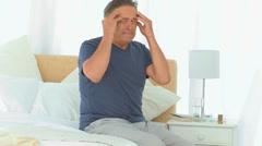 Elderly man having a huge headache Stock Footage