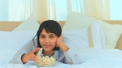 Good looking asian lady watching the tv Stock Footage