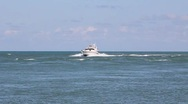 Stock Video Footage of Water scenic motor yacht enters inlet on plane and slows to idle h264