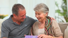 Middle aged couple with a gift Stock Footage