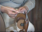 Stock Video Footage of Spinning Wool on Loom