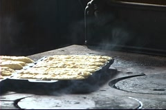 Cornbread Cooking on an Antique Stove Stock Footage