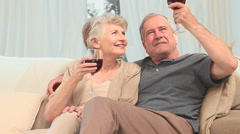 Lovely retired couple enjoying a glass of red wine Stock Footage